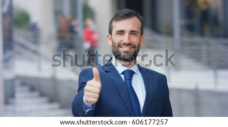 stock-photo-a-man-in-a-suit-looks-in-cam